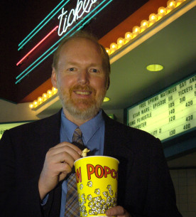 "Glenn Sparks, a professor of communication, says violence like hitting, punching, shooting and killing, may not really contribute to the overall appeal of a film. To determine if people enjoy violence in movies, Sparks and his research team questioned 134 adults after half of the group watched the full-length version of ""The Fugitive,"" a 1993 movie. The other half of the participants watched an edited version of the film with most of the violence Ñ about 11 minutes worth Ñ deleted. This group reported enjoying the movie as much as the group that watched the unedited version. (Purdue News Service photo/David Umberger)"
