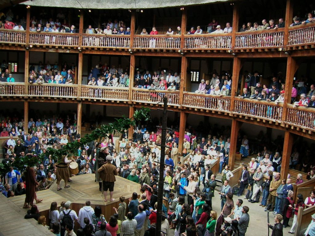 An audience at The Globe, where Shakespearean plays are still held to this day.